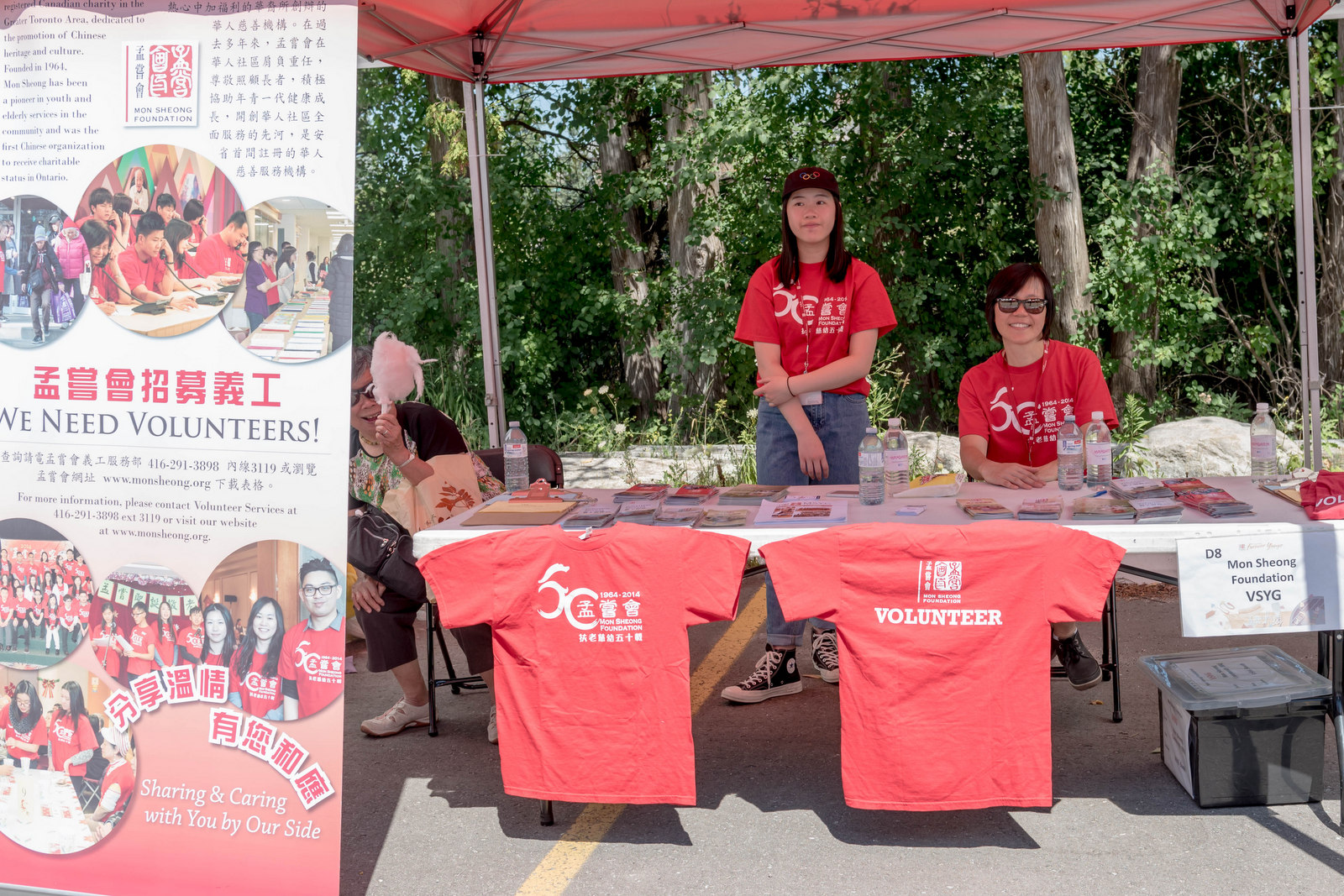 Volunteer in Mon Sheong booth
