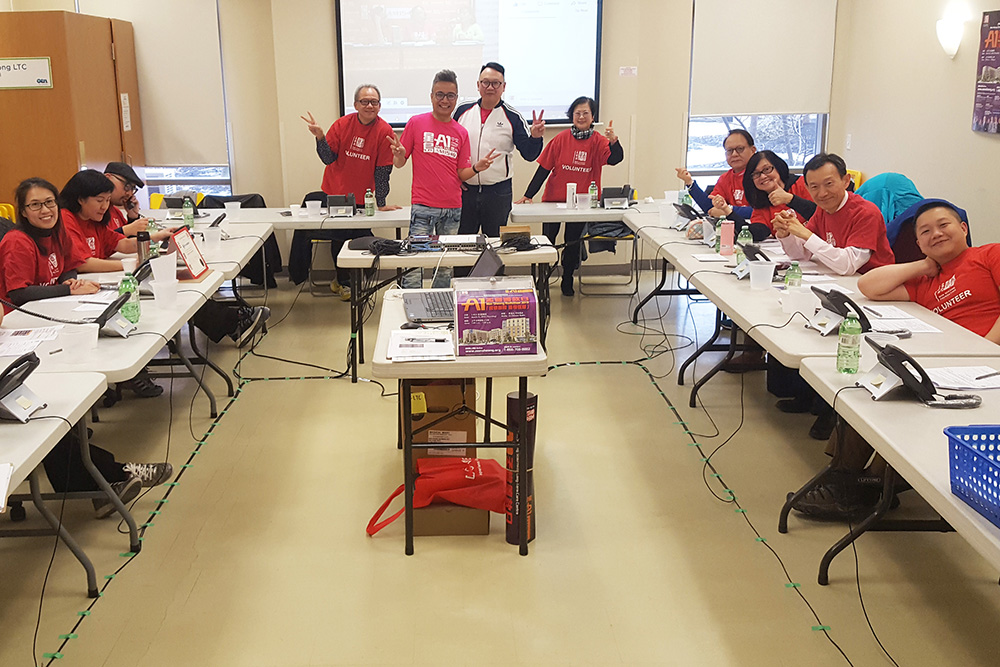 radiothon with many people wear red tshirt with phones on table
