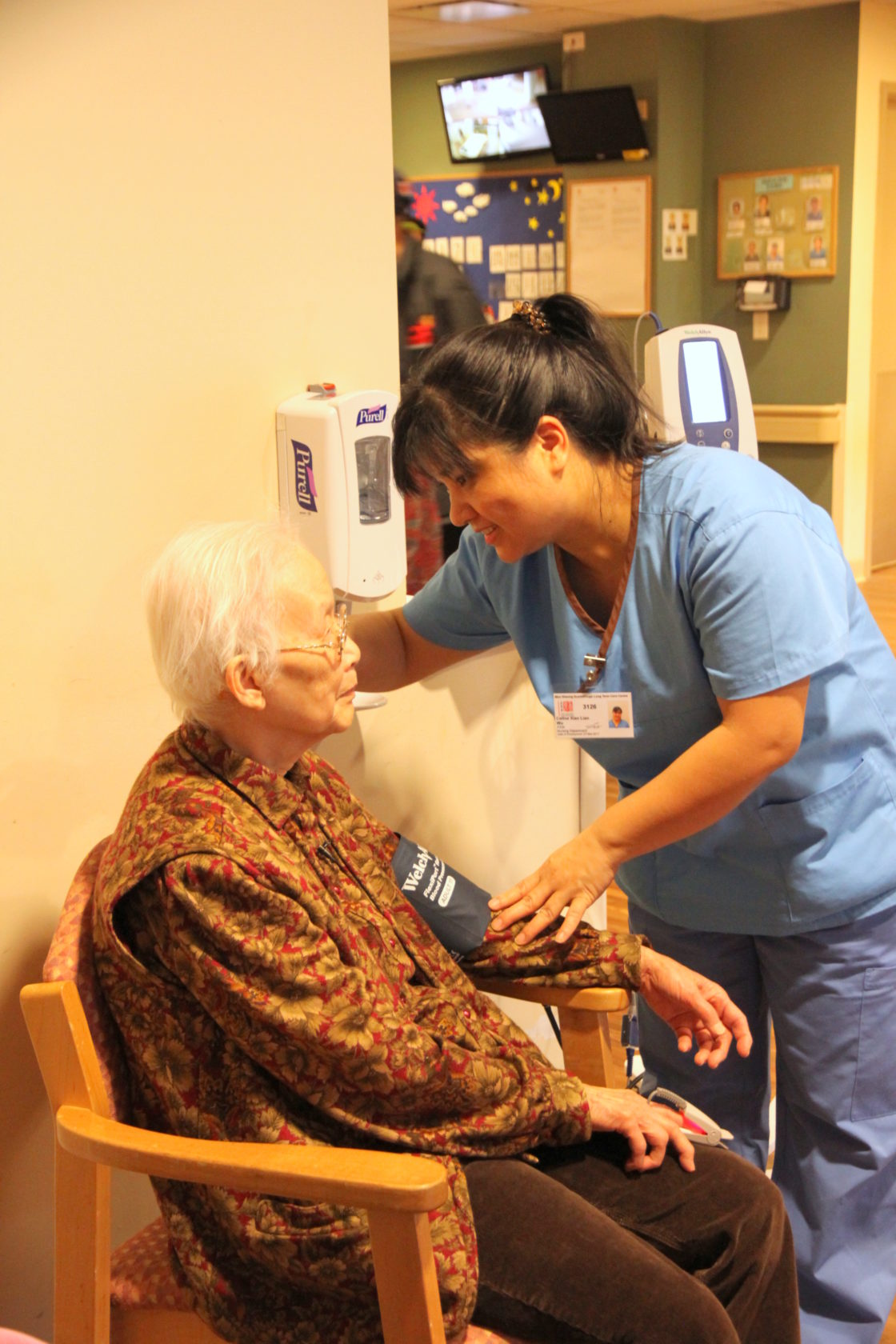 Long Term Care Centre senior chats with registered nurse