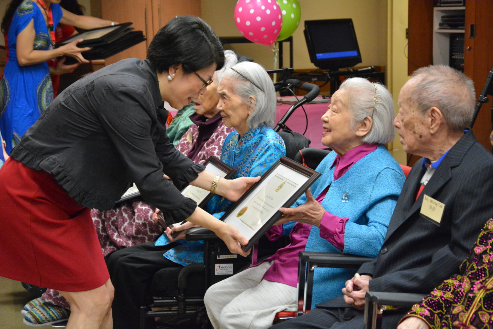 100th birthday party at Mon Sheong Home of the Aged with awards