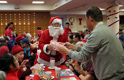 Community Christmas Party at D'arcy Santa Claus celebrating with seniors